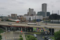 Interstate 244 straddles Greenwood Avenue in Tulsa, Okla., on Monday, May 24, 2021. The highway bisects the neighborhood and separates the Greenwood area from downtown Tulsa. (AP Photo/Sue Ogrocki)