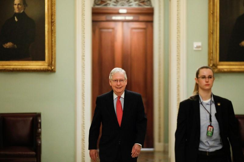 U.S. Senate Majority Leader McConnell enters the Senate Chamber Floor after Congress agreed to a multi-trillion dollar economic stimulus package created in response to the economic fallout from the COVID-19 Coronavirus, on Capitol Hill in Washington