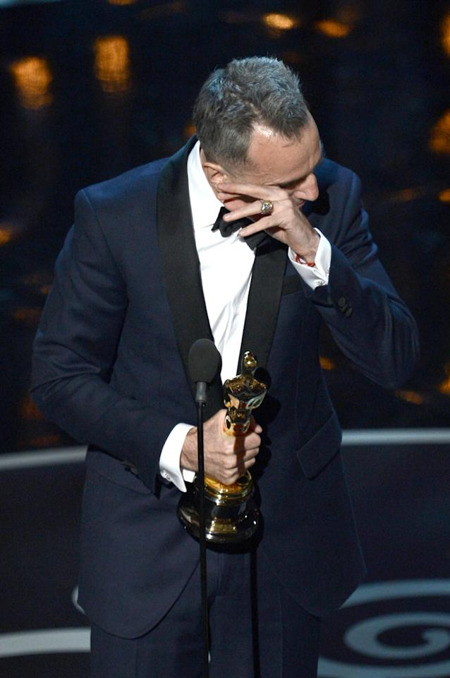 "HOLLYWOOD, CA - FEBRUARY 24:  Actor Daniel Day-Lewis accepts the Best Actor award for ""Lincoln"" onstage during the Oscars held at the Dolby Theatre on February 24, 2013 in Hollywood, California.  (Photo by Kevin Winter/Getty Images)"