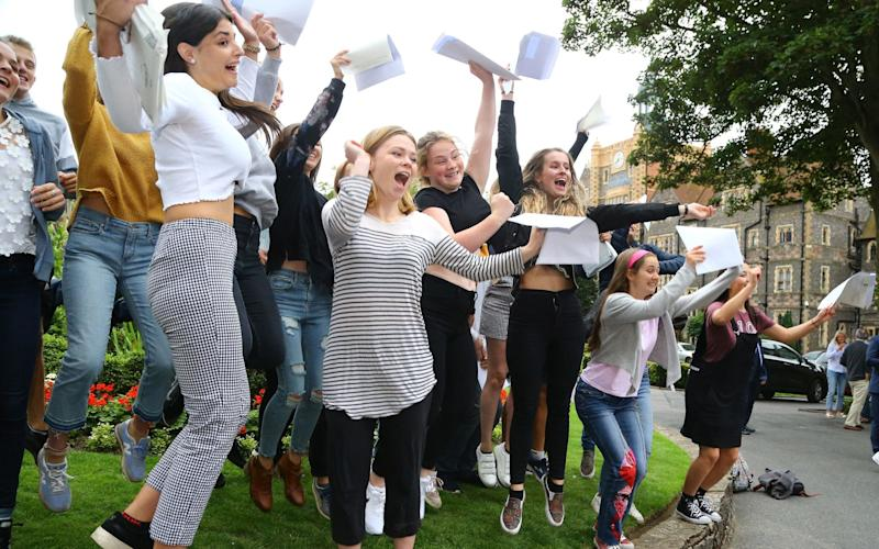 Students celebrate their A-level results at Brighton College. Many courses have been re-designed this year, with coursework and modules axed - PA
