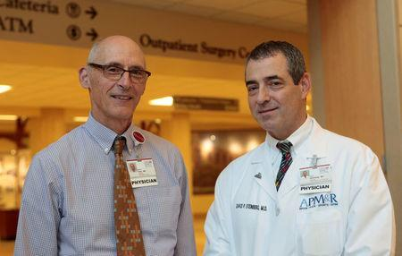 Dr. David Steinberg, Chief of Staff, Saint Joseph Mercy Health System and Dr. Steven Thiry, former chair, Dept of Family Medicine stand together in the lobby of Saint Joseph Mercy hospital in Ypsilanti, Michigan, U.S., August 23, 2017. Picture taken August 23, 2017. REUTERS/Rebecca Cook