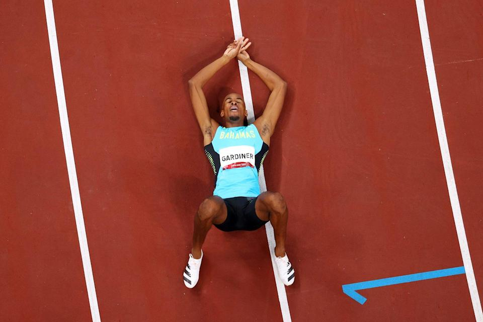 <p>Steven Gardiner of Team Bahamas soaks in his gold medal win at the Men's 400m Final at Olympic Stadium on August 5.</p>