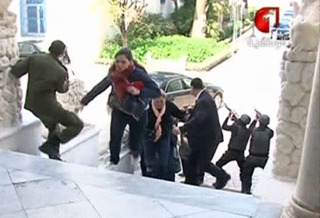 A still image taken from video shows tourists running for cover as armed men stand guard at Tunisia's national museum in Tunis March 18, 2015. REUTERS/Tunisia TV handout via Reuters TV