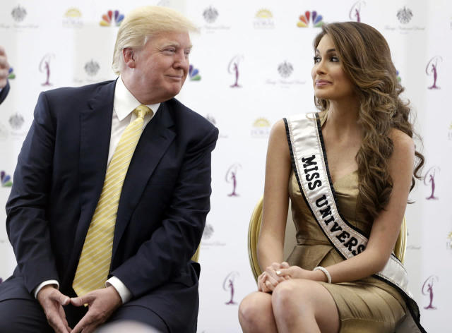 <p>Donald Trump and Miss Universe, Gabriela Isler of Venezuela, at a news conference on Oct. 2, 2014, in Doral, Fla. <i>(Photo: Wilfredo Lee/AP)</i> </p>