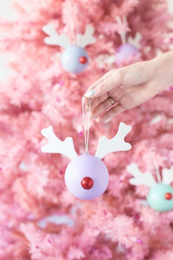 """<p>We love this idea for ornaments—but they'd make for super-cute gift toppers too. Make more than one, and you've got yourself an entire herd of pastel-colored reindeer. </p><p><strong>Get the tutorial at <a href=""""https://studiodiy.com/2015/12/09/diy-rudolph-ornaments/"""" rel=""""nofollow noopener"""" target=""""_blank"""" data-ylk=""""slk:Studio DIY"""" class=""""link rapid-noclick-resp"""">Studio DIY</a>.</strong></p><p><strong><a class=""""link rapid-noclick-resp"""" href=""""https://www.amazon.com/slp/red-pom-poms/335r4she4fdr645?tag=syn-yahoo-20&ascsubtag=%5Bartid%7C10050.g.1070%5Bsrc%7Cyahoo-us"""" rel=""""nofollow noopener"""" target=""""_blank"""" data-ylk=""""slk:SHOP RED POM-POMS"""">SHOP RED POM-POMS</a><br></strong></p>"""