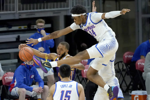 DePaul's Nick Ongenda (14) pressures Western Illinois' Justin Brookens under the basket during the first half of an NCAA college basketball game Wednesday, Dec. 23, 2020, in Chicago. (AP Photo/Charles Rex Arbogast)