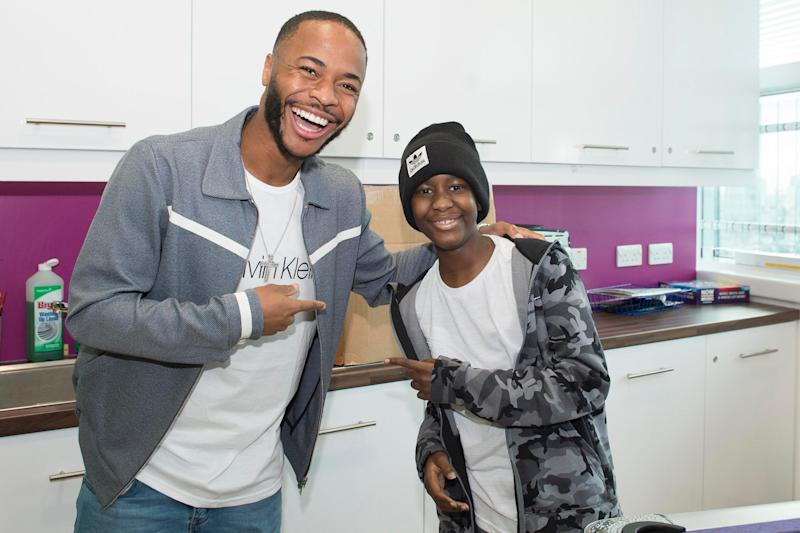 Star supporter: Raheem Sterling visiting Damary Dawkins (Graham Chadwick/Daily Mail)