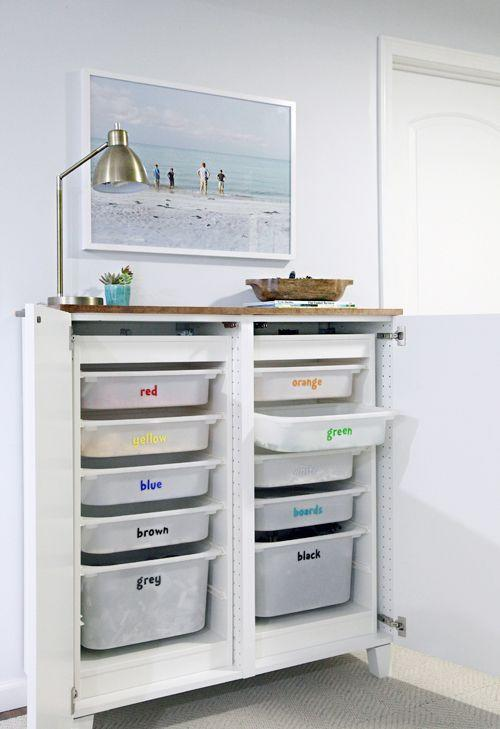 """<p>Keep Legos organized by labeling drawers by color to make cleanup quick and easy. </p><p><strong>See more at <a href=""""http://www.iheartorganizing.com/2016/05/boys-den-update-concealed-lego-storage.html"""" rel=""""nofollow noopener"""" target=""""_blank"""" data-ylk=""""slk:I Heart Organizing"""" class=""""link rapid-noclick-resp"""">I Heart Organizing</a>.</strong></p><p><strong><strong><a class=""""link rapid-noclick-resp"""" href=""""https://www.amazon.com/s?k=plastic+storage+bins&ref=nb_sb_noss_2&tag=syn-yahoo-20&ascsubtag=%5Bartid%7C10063.g.36014277%5Bsrc%7Cyahoo-us"""" rel=""""nofollow noopener"""" target=""""_blank"""" data-ylk=""""slk:SHOP PLASTIC STORAGE BINS"""">SHOP PLASTIC STORAGE BINS</a></strong><br></strong></p>"""