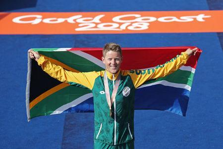 Gold medallist Henri Schoeman of South Africa. REUTERS/Athit Perawongmetha