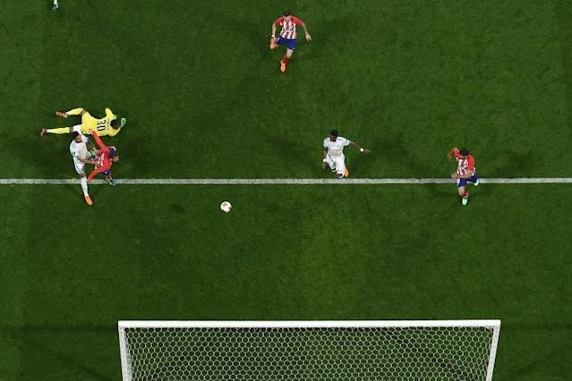 Atletico Madrid's French forward Antoine Griezmann scores the second goal during the UEFA Europa League final against Olympique de Marseille