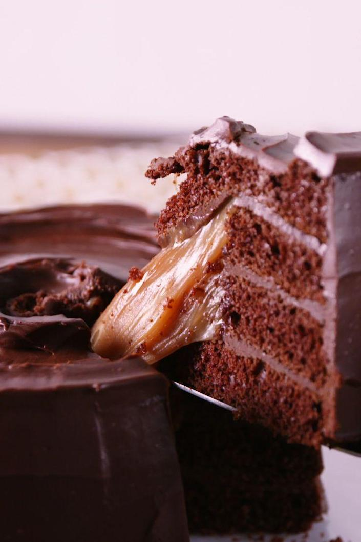 """<p>Rolo lovers, try not to freak out when you see this cake.</p><p>Get the recipe from <a href=""""https://www.delish.com/cooking/recipe-ideas/recipes/a54826/giant-rolo-cake-recipe/"""" rel=""""nofollow noopener"""" target=""""_blank"""" data-ylk=""""slk:Delish"""" class=""""link rapid-noclick-resp"""">Delish</a>.</p>"""