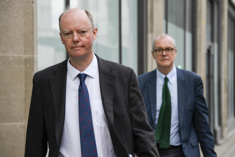 Chief Medical Officer Professor Chris Whitty, left and Chief Scientific Adviser Sir Patrick Vallance walk after the virtual press conference in which the Government announced that the legal limit on social gatherings is set to be reduced from 30 people to six. in London, Wednesday, Sept. 9, 2020. (AP Photo/Alberto Pezzali)