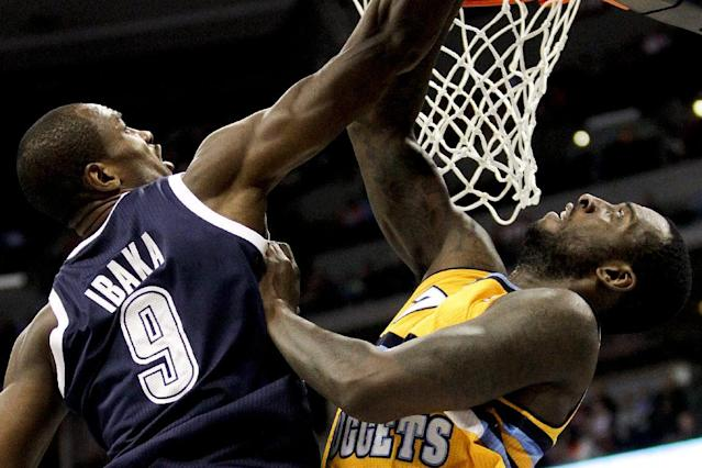 Oklahoma City Thunder's Serge Ibaka (9) and Denver Nuggets' J.J. Hickson (7) compete for a rebound during the first quarter of an NBA basketball game Thursday, Jan. 9, 2014, in Denver. (AP Photo/Barry Gutierrez)