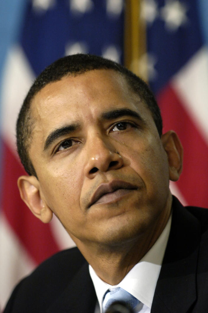 """""""When I started this campaign people called me a young man…They're not calling me that anymore,"""" Obama told the """"Early Show"""" in August 2008. In a now iconic image, then-Senator Barack Obama listens at the National Press Club in Washington on April 27, 2006. (AP Photo/Mannie Garcia, File)"""