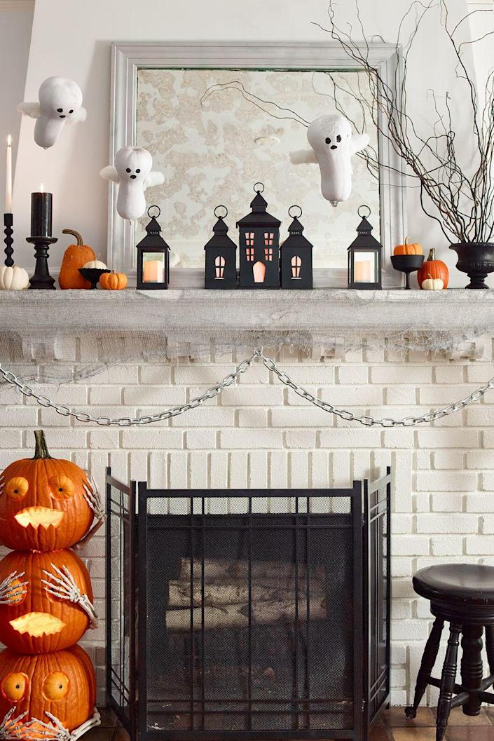 """<p>Build an eerie Halloween village with black metal lanterns, then add LED lights for a candlelit glow.</p><p><em><strong><a href=""""https://www.womansday.com/home/crafts-projects/g22840971/halloween-2018-templates/"""" rel=""""nofollow noopener"""" target=""""_blank"""" data-ylk=""""slk:Get the Spooky Mantle Display template."""" class=""""link rapid-noclick-resp"""">Get the Spooky Mantle Display template.</a></strong></em></p><p><strong>What You'll Need:</strong> <a href=""""https://www.amazon.com/Flameless-Vivii-Battery-powered-Unscented-Tealights/dp/B01MQ1Q3R1/?tag=syn-yahoo-20&ascsubtag=%5Bartid%7C10070.g.1908%5Bsrc%7Cyahoo-us"""" rel=""""nofollow noopener"""" target=""""_blank"""" data-ylk=""""slk:LED lights"""" class=""""link rapid-noclick-resp"""">LED lights</a> ($10 for 36, Amazon)</p>"""