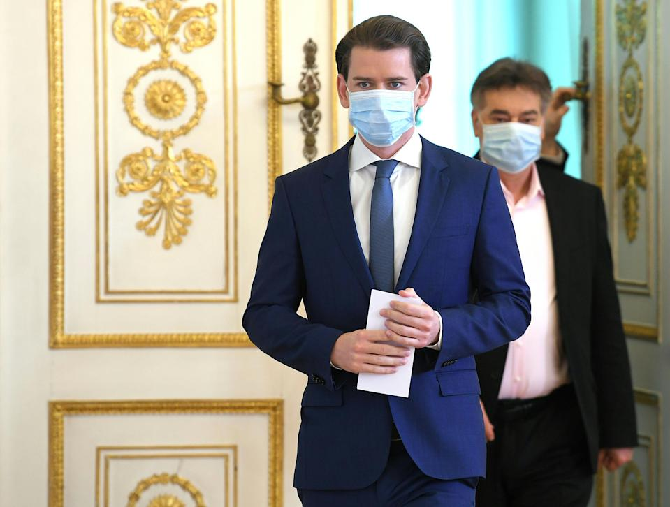 Austria's Chancellor Sebastian Kurz (L) and Vice-Chancellor Werner Kogler wear face masks as they arrive to address a press conference at the Chancellery in Vienna on April 29, 2020, amid the novel coronavirus COVID-19 pandemic. (Photo by ROLAND SCHLAGER / APA / AFP) / Austria OUT (Photo by ROLAND SCHLAGER/APA/AFP via Getty Images)