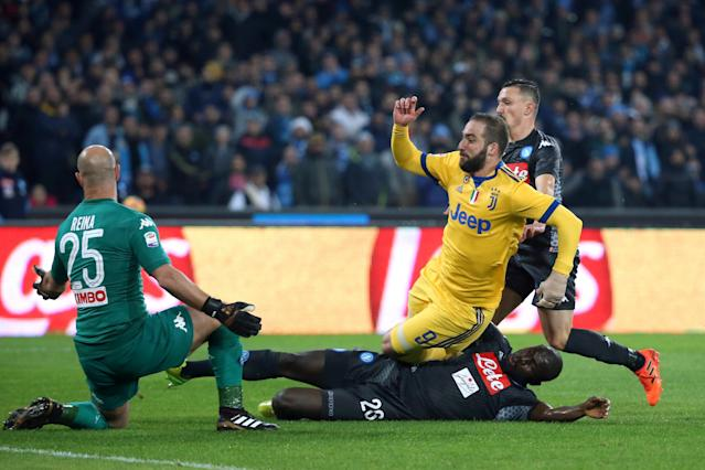 FILE PHOTO: Soccer Football - Serie A - Napoli vs Juventus - Stadio San Paolo, Naples, Italy - December 1, 2017 Juventus' Gonzalo Higuain scores their first goal REUTERS/Tony Gentile/File Photo