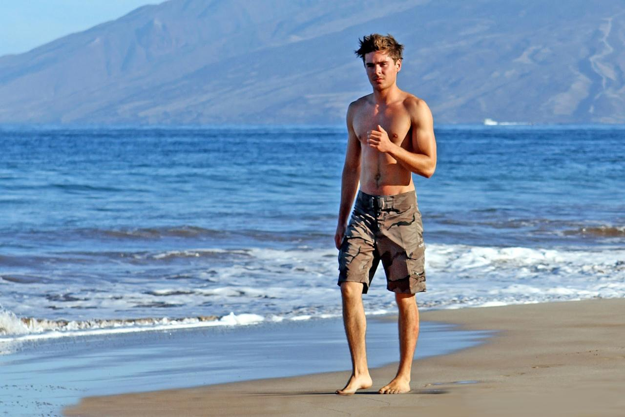 <p>This is Zac Efron taking a walk at the beach.</p>
