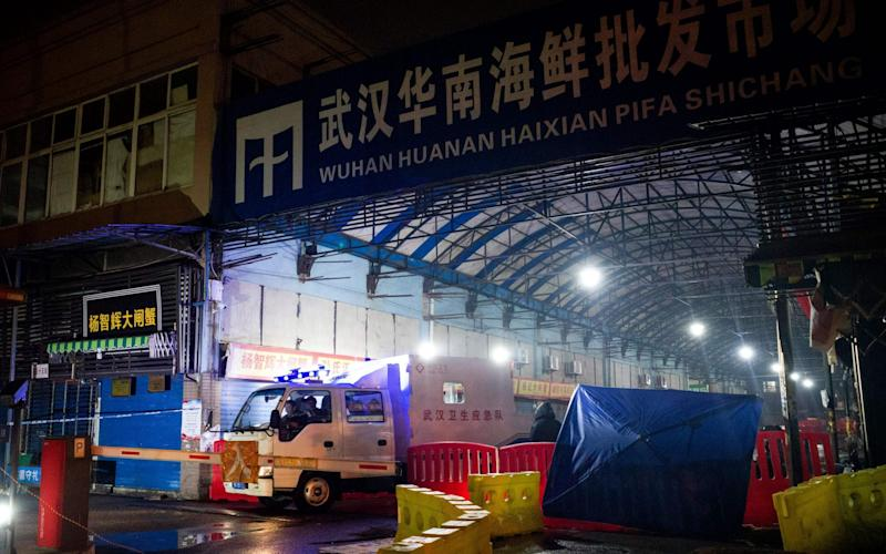 The Wuhan Hygiene Emergency Response Team  leaving the closed Huanan Seafood Wholesale Market in the city of Wuhan, where the coronavirus outbreak is thought to have originated - AFP
