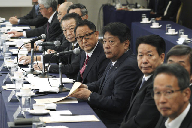 CORRECTS COMPANY NAME TO TOYOTA MOTOR CORP. - Akio Toyoda, center, president and CEO of Toyota Motor Corp., with a group of the Japanese automakers chiefs attend a meeting with Japanese Trade Minister Isshu Sugawara, not in picture, Thursday, Sept. 26, 2019, in Tokyo. The U.S. and Japan on Wednesday signed a limited trade deal that will eliminate tariffs and expand market access on farm, industrial and digital products. But the deal does not address autos, a key sticking point during months of contentious negotiations, and President Donald Trump indicated the two countries were still working on a broader agreement. (AP Photo/Eugene Hoshiko)