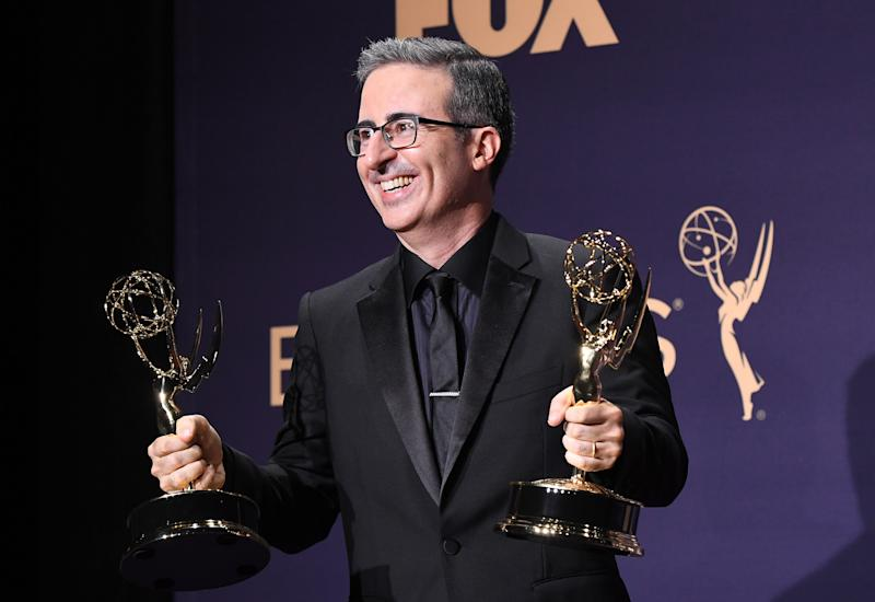 LOS ANGELES, CALIFORNIA - SEPTEMBER 22: John Oliver poses with award for Outstanding Variety Talk Series in the press room during the 71st Emmy Awards at Microsoft Theater on September 22, 2019 in Los Angeles, California. (Photo by Steve Granitz/WireImage)