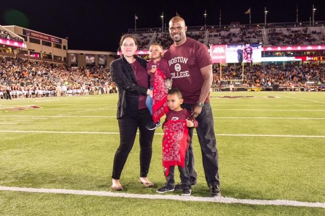 Brian Flores, with his wife Jennifer and two of his three children, left quite the impression at alma mater. (Photo courtesy of Boston College)