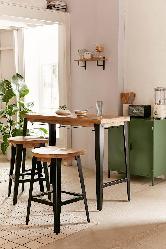 """<p>If you have a small dining space, get this <a href=""""https://www.popsugar.com/buy/Haskall-Breakfast-Bar-464891?p_name=Haskall%20Breakfast%20Bar&retailer=urbanoutfitters.com&pid=464891&price=379&evar1=casa%3Aus&evar9=46240735&evar98=https%3A%2F%2Fwww.popsugar.com%2Fhome%2Fphoto-gallery%2F46240735%2Fimage%2F46886262%2FHaskall-Breakfast-Bar&list1=shopping%2Cfurniture%2Csmall%20space%20living%2Capartment%20living%2Chome%20shopping&prop13=mobile&pdata=1"""" rel=""""nofollow"""" data-shoppable-link=""""1"""" target=""""_blank"""" class=""""ga-track"""" data-ga-category=""""Related"""" data-ga-label=""""https://www.urbanoutfitters.com/shop/haskall-breakfast-bar?category=furniture&amp;color=001&amp;type=REGULAR"""" data-ga-action=""""In-Line Links"""">Haskall Breakfast Bar</a> ($379). The chairs can be store and hunt underneath.</p>"""