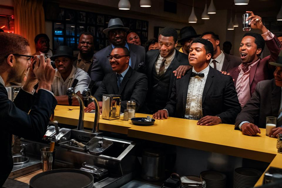 "Malcolm X (Kingsley Ben-Adir, from left) takes a picture of his friends Jim Brown (Aldis Hodge), Cassius Clay (Eli Goree) and Sam Cooke (Leslie Odom Jr.) in ""One Night in Miami."""