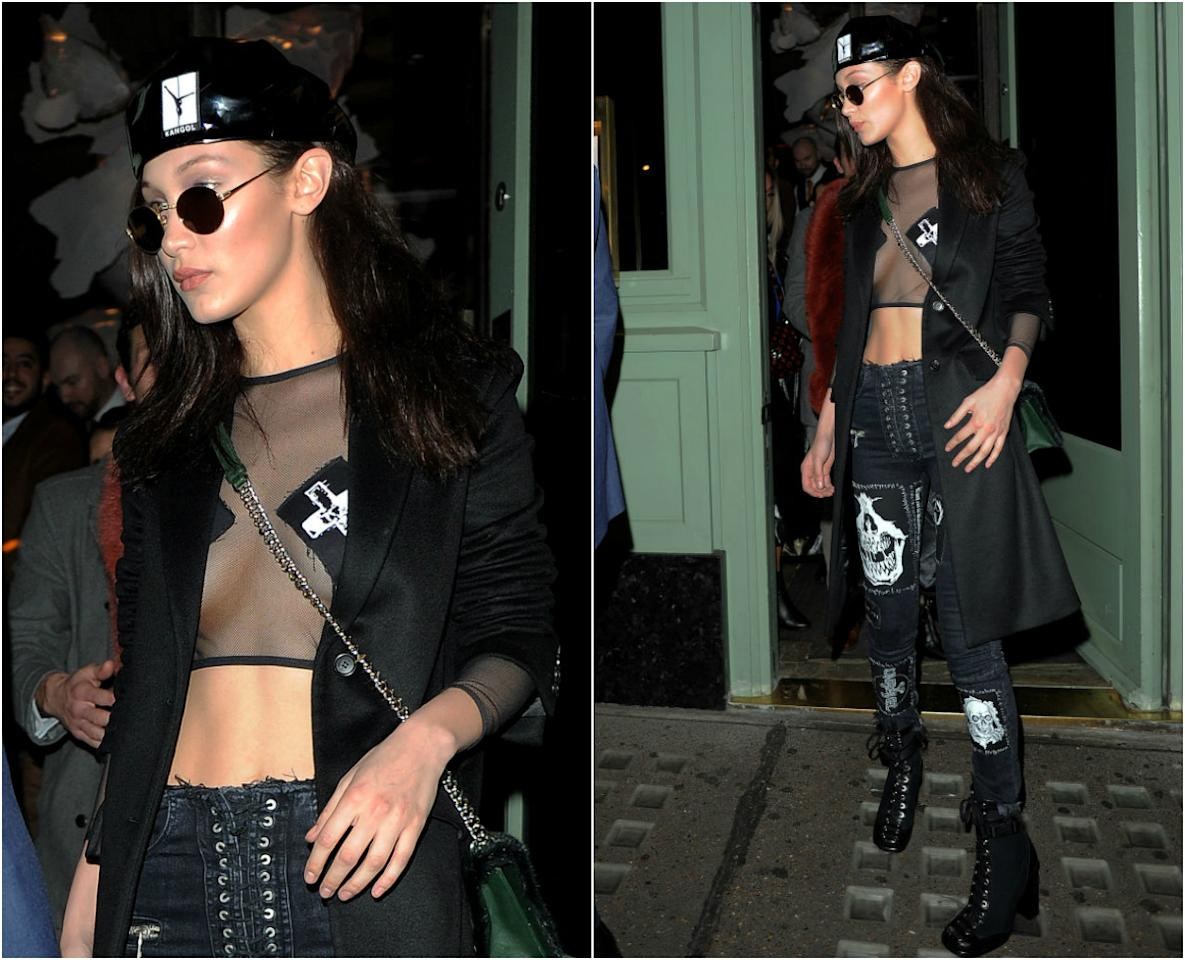 <div><b>When: Feb. 18 2017</b> <br /> Bella Hadid was spotted baring her bod in a sexy, see-through mesh crop top and cross-shaped pasties as she hitted a nightclub with Kendall Jenner during London Fashion week. The supermodel modestly paired the top with a black trench coat and low-rise, skull patterned lace-up jeans—giving us all sorts of effortlessly chic vibes! Are you loving the sheer top? <i>(Photos: Getty)</i> </div>