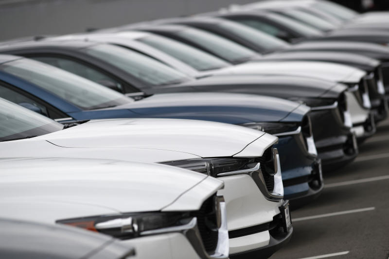 FILE- In this May 19, 2019, file photo, a line of unsold 2019 CX-5 sports-utility vehicles sits at a Mazda dealership in Littleton, Colo. On Friday, June 14, the Commerce Department releases U.S. retail sales data for May. (AP Photo/David Zalubowski, File)