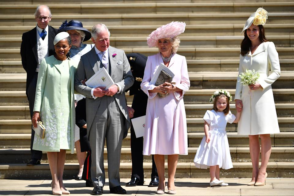 Doria Ragland, Prince Charles, Prince of Wales, Camilla, Duchess of Cornwall, and Catherine, Duchess of Cambridge holding her daughter Princess Charlotte's hand as they leave from the West Door of St George's Chapel, Windsor Castle,