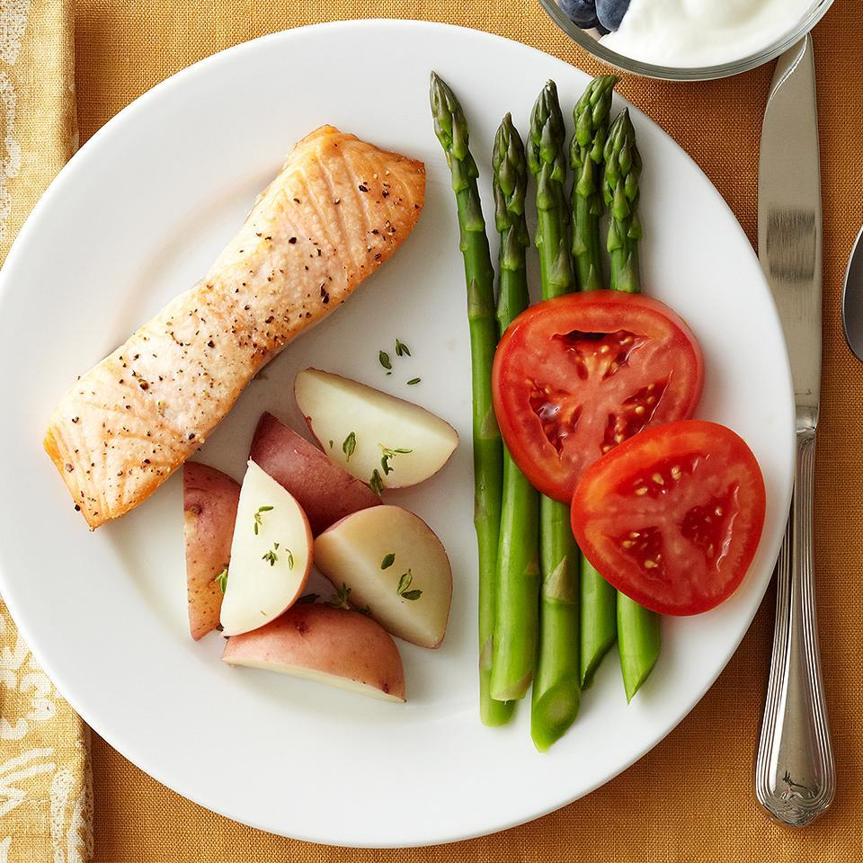 "<p>This quick-and-easy recipe is loaded with bold flavors and combines heart-healthy salmon with roasted or grilled asparagus. We recommend roasting or grilling the salmon and asparagus together to save time. To ramp up the flavor in this dish, use a dab of extra-virgin olive oil, snipped fresh parsley, finely shredded lemon peel, and ground black pepper. <a href=""http://www.eatingwell.com/recipe/263678/salmon-and-asparagus/"" rel=""nofollow noopener"" target=""_blank"" data-ylk=""slk:View recipe"" class=""link rapid-noclick-resp""> View recipe </a></p>"