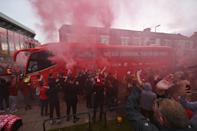 Fans applaud as the Liverpool team bus arrives at Anfield ahead of their final home match of the 2019/20 season against Chelsea. (PHOTO: Oli Scarff/AFP via Getty Images)