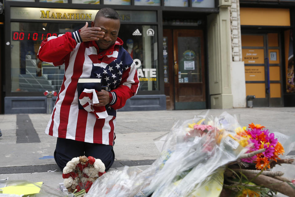 A man is seen praying in front of a Boston Marathon bombing memorial on the occasion's five-year anniversary. People who watched repeated, graphic footage of the bombing exhibited mental and physical stress, research found. (Photo: Jessica Rinaldi/The Boston Globe via Getty Images)