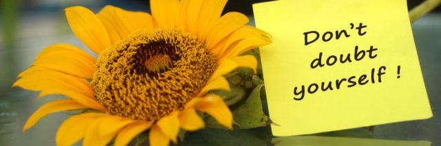 dont doubt yourself on a note with a sunflower