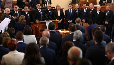 Bulgaria's new Prime Minister Boiko Borisov and members of his cabinet take an oath during a swearing-in ceremony in the parliament in Sofia, Bulgaria May 4, 2017. REUTERS/Stoyan Nenov
