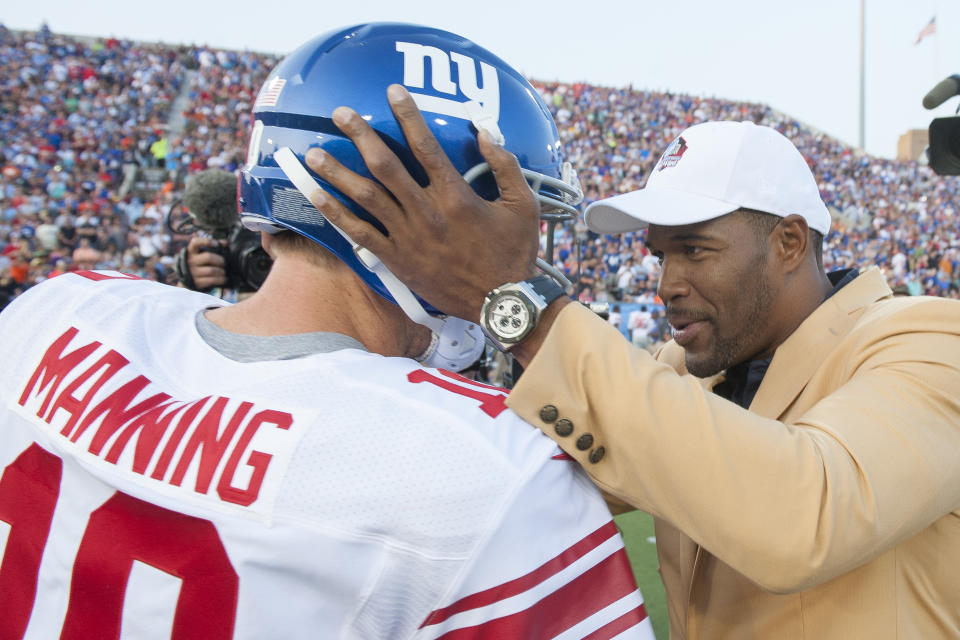 Eli Manning and Michael Strahan with the Giants.