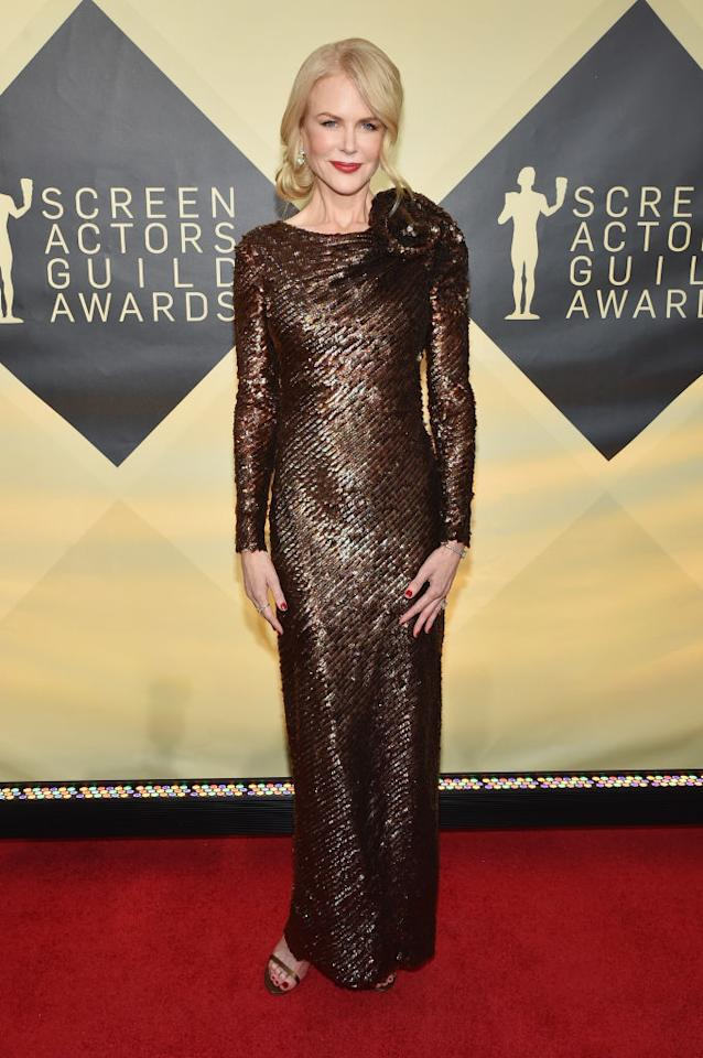 <p>For the awards ceremony, Nicole Kidman donned a metallic gown by Armani Privé and accessorised with Harry Winston jewels. <em>[Photo: Getty]</em> </p>