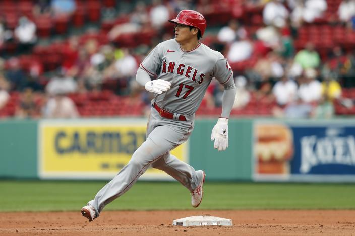 Los Angeles Angels' Shohei Ohtani rounds second base on a double by Jared Walsh during the fifth inning of a baseball game against the Boston Red Sox, Sunday, May 16, 2021, in Boston. (AP Photo/Michael Dwyer)