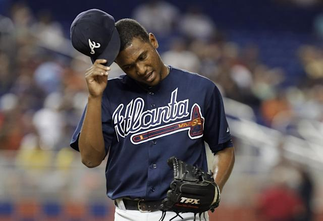 Atlanta Braves starting pitcher Julio Teheran takes off his cap after being relieved in the seventh inning during a baseball game against the Miami Marlins, Tuesday, Sept. 10, 2013, in Miami. The Braves defeated the Marlins 4-3. (AP Photo/Lynne Sladky)