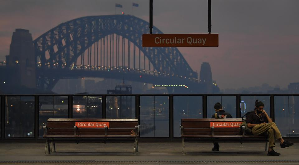 The Sydney Harbour Bridge can be seen while commuters wait from trains at Circular Quay station on Monday. Source: AAP