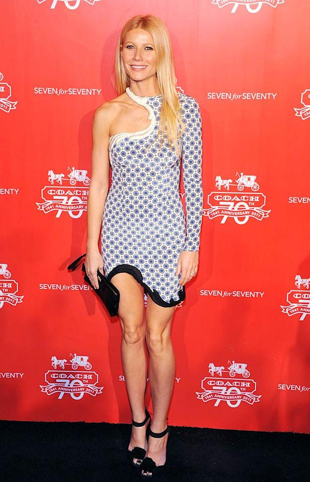 Love her or hate her, there's no denying how amazing Gwyneth Paltrow looked at Coach's 70th anniversary celebration in Beijing, China. Once again, the actress wore one of her pal Stella McCartney's dresses. Are you as big a fan of the print, the swirling neckline, the contrasting hemline, and the one long sleeve as we are?  (11/17/2011)