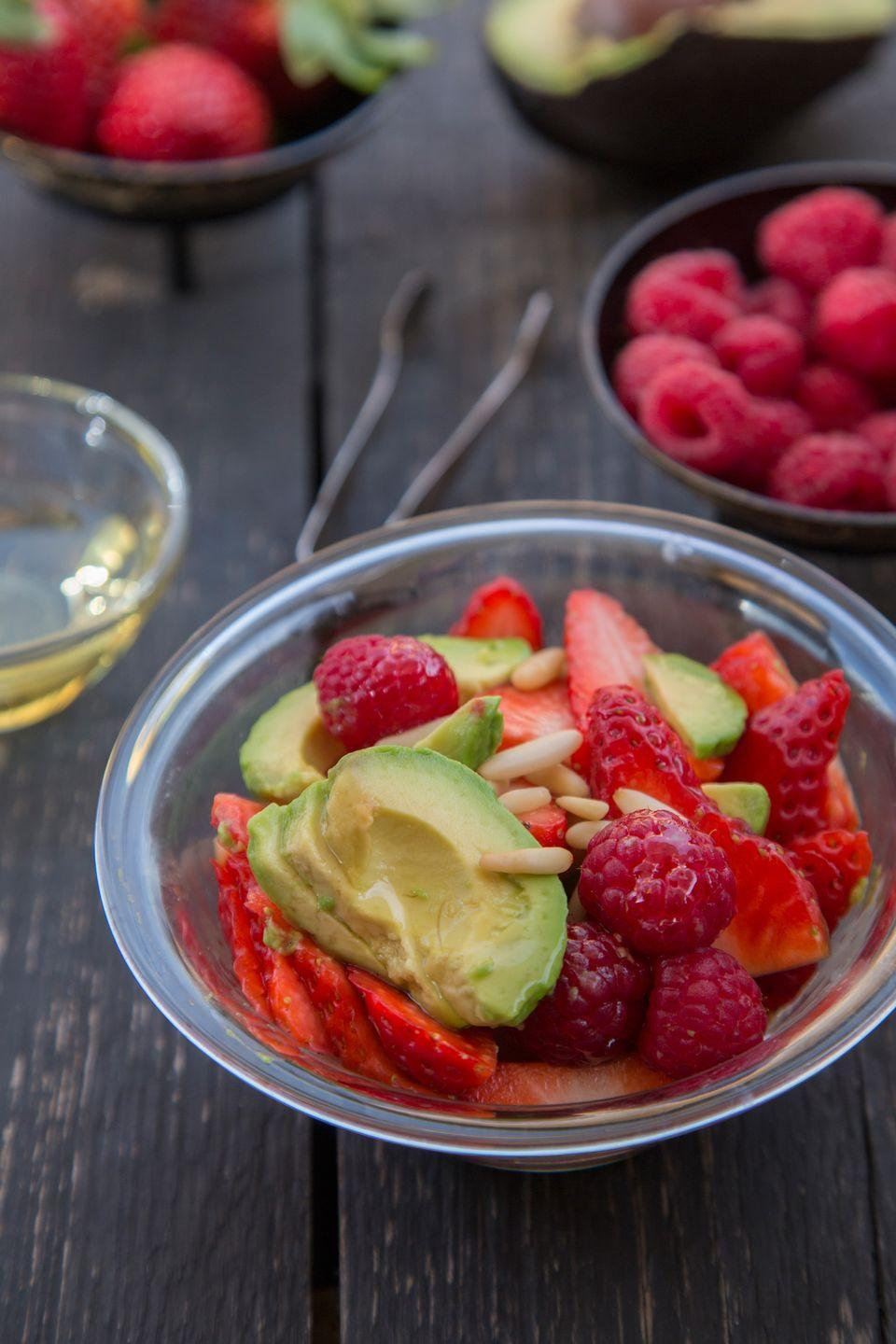 """<p>Luscious strawberries and creamy avocado mingle in a honeyed lemon dressing to create this simple and elegant salad. Try tossing some raspberries in there, too!</p><p><strong><a href=""""https://www.countryliving.com/food-drinks/recipes/a812/avocado-strawberries-honey-vinaigrette/"""" rel=""""nofollow noopener"""" target=""""_blank"""" data-ylk=""""slk:Get the recipe"""" class=""""link rapid-noclick-resp"""">Get the recipe</a>.</strong></p>"""