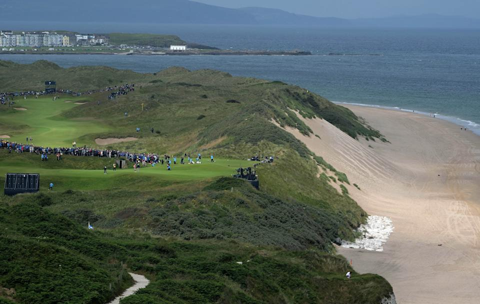 The group consisting of reigning Open champion Francesco Molinari, Bryson DeChambeau and Adam Scott putt on the 5th green during the first round of the 148th Open Championship held on the Dunluce Links at Royal Portrush Golf Club on July 18, 2019 in Portrush, United Kingdom. (Photo by Charles McQuillan/R&A/R&A via Getty Images)