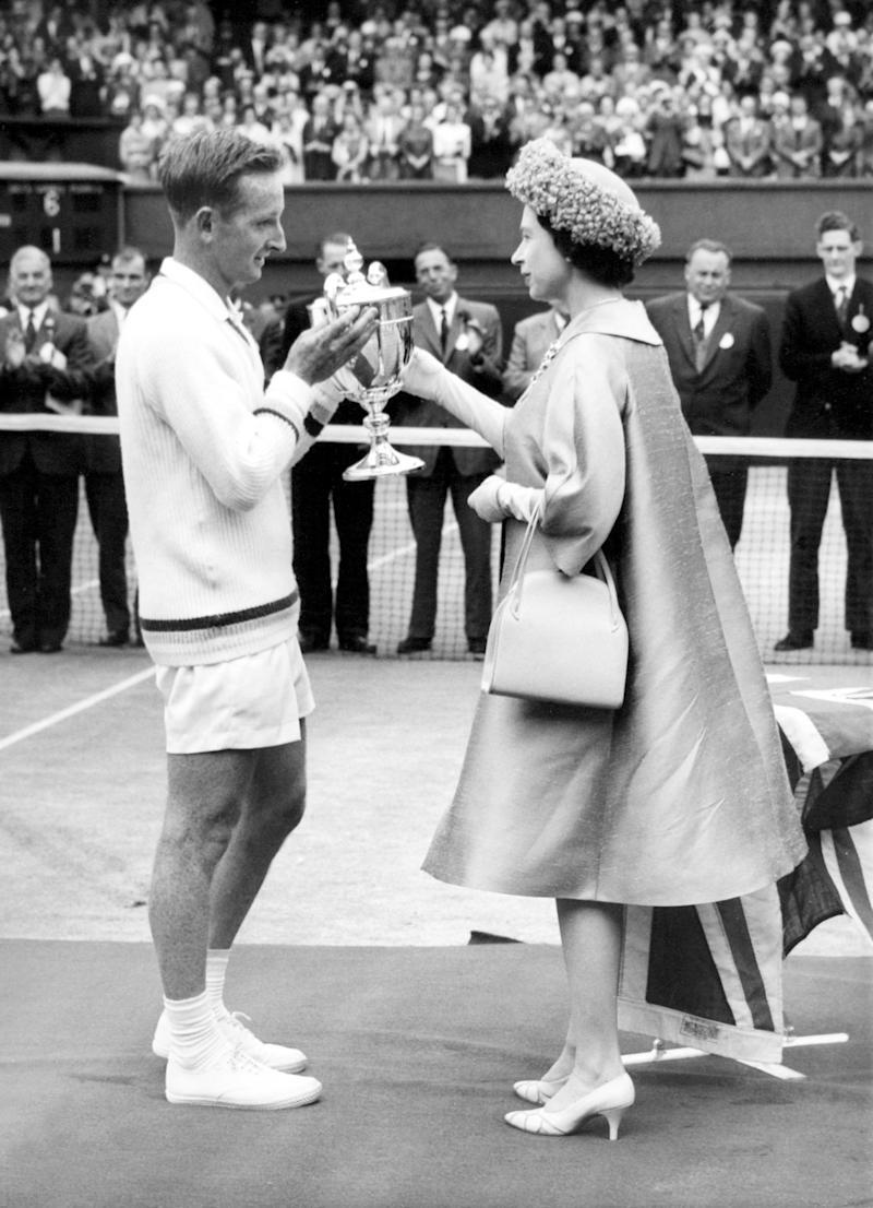 Queen Elizabeth II presents the men's singles trophy to champion Rod Laver on September 10th, 1962. Photo courtesy of Getty Images.