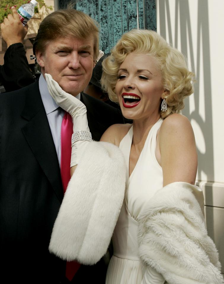 DONALD TRUMP WITH MARILYN MONROE CHARACTER AT UNIVERSAL STUDIOS. 2004. Fred Prouser / Reuters
