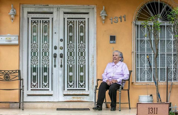 Lazara Ana Rodriguez sits outside her home in Miami on Tuesday, Feb. 23, 2021. She is an 82-year-old survivor of a Castro prison at risk of being evicted.