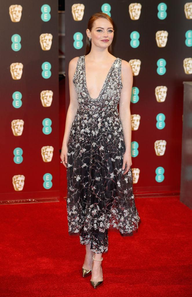 <p>Emma went for the dress-over-trousers look in a gorgeous Chanel number. <i>[Photo: Getty Images]</i> </p>