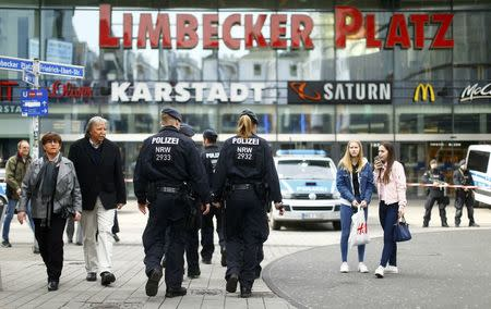 Police walks towards the Limbecker Platz shopping mall in Essen, Germany, March 11, 2017, after it was shut due to attack threat.      REUTERS/Thilo Schmuelgen