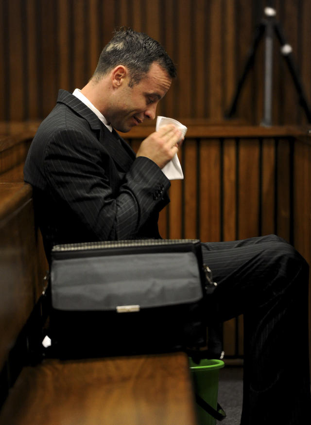 Oscar Pistorius, sits in the dock as he waits for proceedings to begin in court in Pretoria, South Africa, Tuesday, March 18, 2014. Pistorius is on trial for the murder of his girlfriend Reeva Steenkamp on Valentines Day, 2013. (AP Photo/Werner Beukes, Pool)